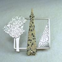 Designer jewellery: handmade sterling silver brooch:  Sterling Silver textured frame brooch with Dalmation Jasper