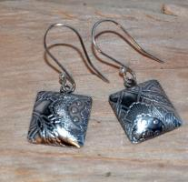Designer jewellery: handmade sterling silver earrings:  Etched and oxidised Sterling Silver hollow form drop earrings.