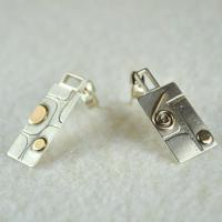Contemporary handmade silver earrings:  Geometric mismatched stud earrings with 9ct Gold